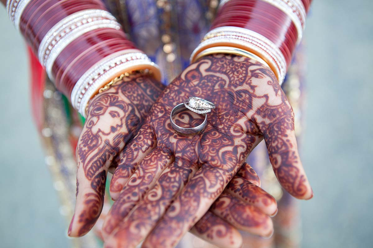Indian Wedding at a Napa winery, Napa wedding photographer Red Eye Collection - henna on hands, holding ring