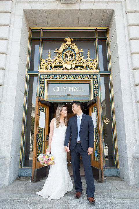 Photo outside San Francisco City Hall entrance - Red Eye Collection wedding photographer