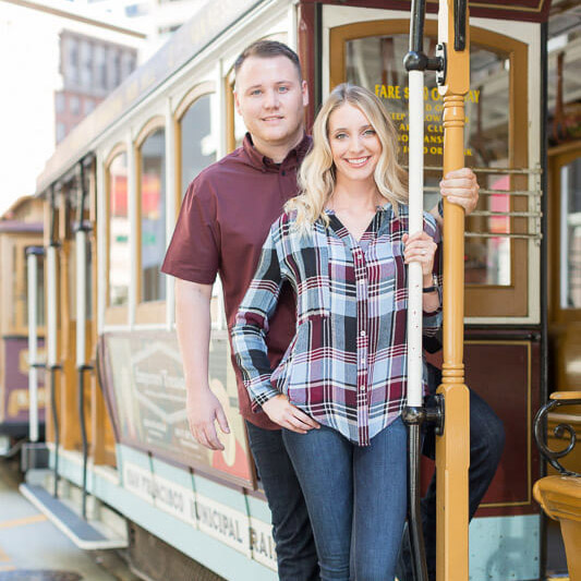 Brittani and Todd cable car San Francisco engagement photo