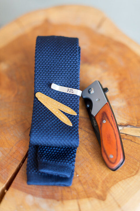 Groom's tie and pocket knife - detail shot