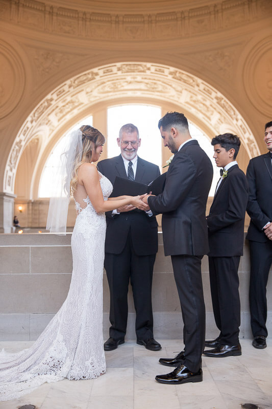 San Francisco City Hall wedding officiant at April and Steven's private ceremony at San Francisco City Hall fourth floor gallery