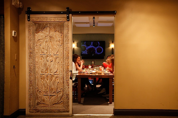 Carved wooden door entrance to E&O's Pearl Room