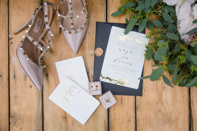 invitation, vows, rings, bride's shoes, and bouquet - disorganized