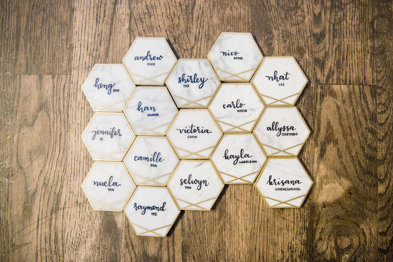 escort cards on tiles with calligraphy
