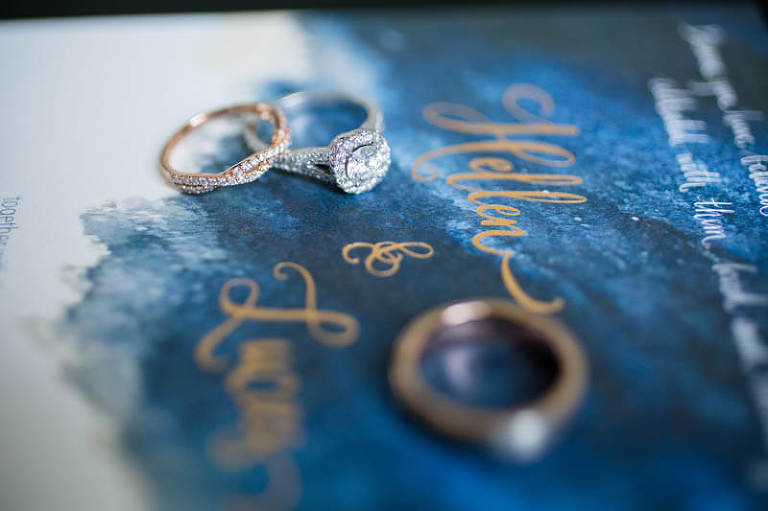 Dark blue wedding invitation with wedding rings