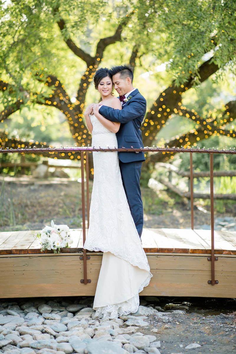Nella Terra bride and groom on bridge