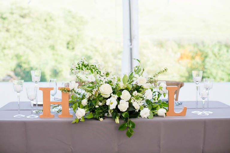 White roses with greenery and letters H and L