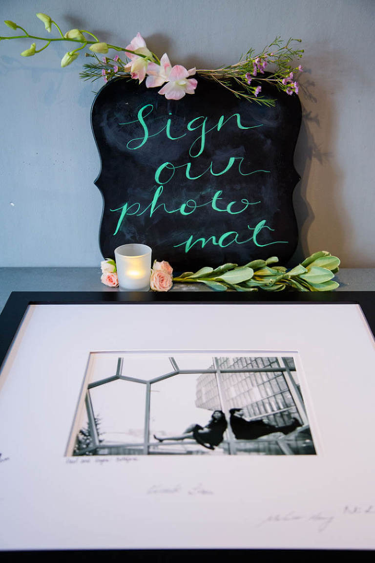 """Chalkboard sign """"Sign our photo mat"""" at wedding"""