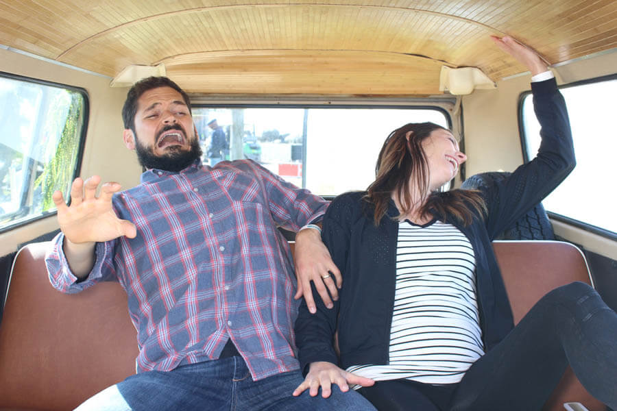couple pretends to be scared inside vw bus photo booth