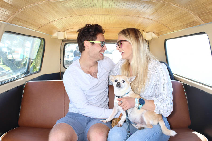young couple with chihuahua inside vw bus photo booth
