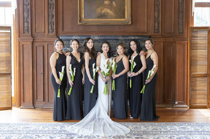Bride with bridesmaids elegant inside Kohl Mansion