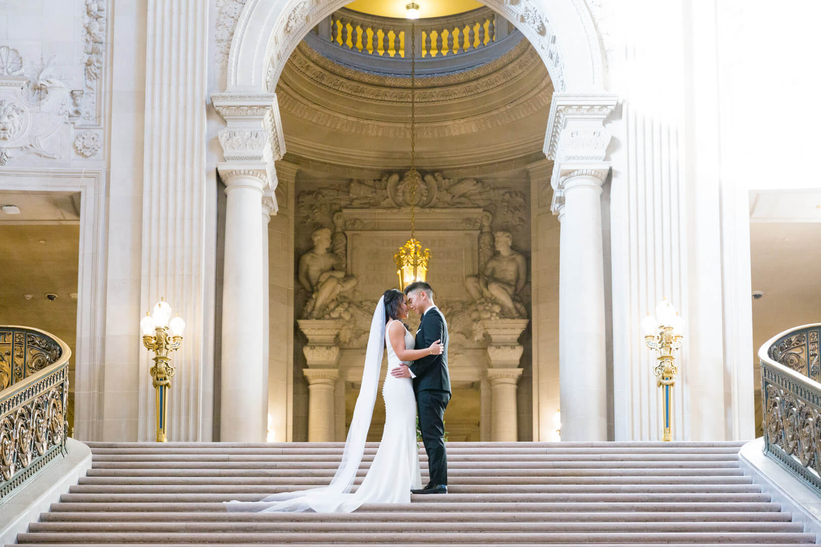 Maya and Kevin SF City Hall wedding photo on the grand staircase