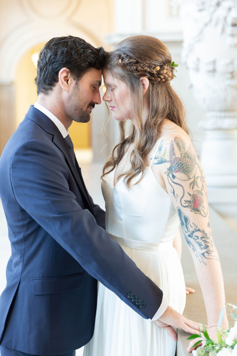 closeup, intimate bride and groom at SF City Hall