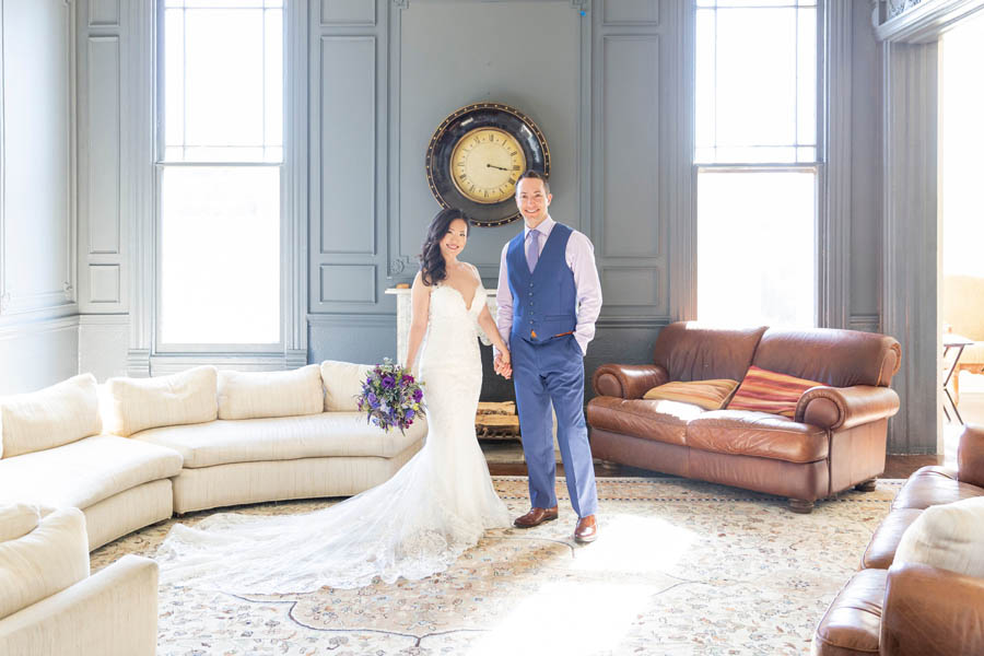 bride and groom in mansion living room