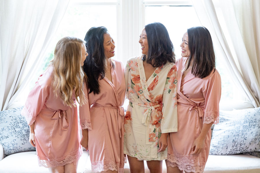 brides and bridesmaids before wedding, wearing robes
