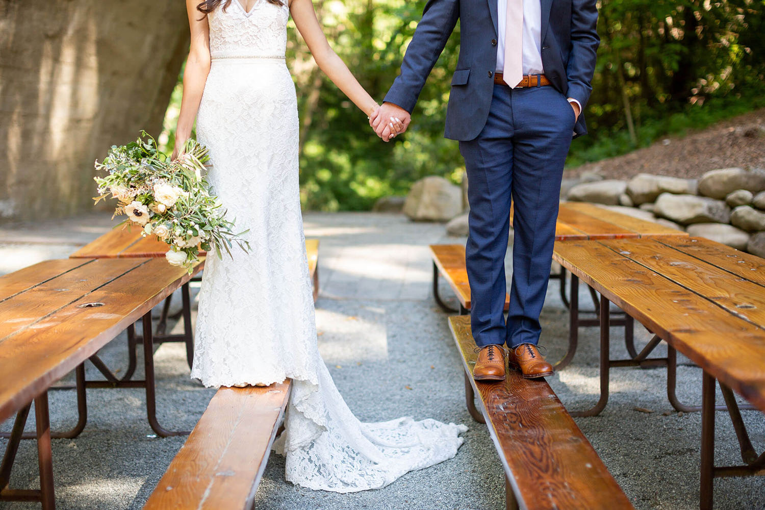 Amanda and Jake standing on benches at their Saratoga Springs wedding
