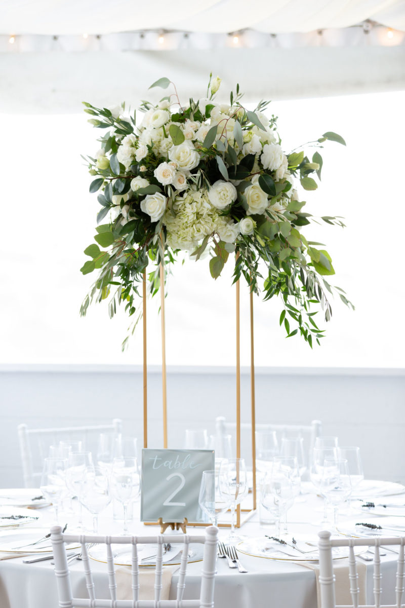 large floral arrangement above table
