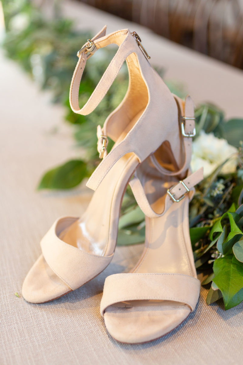 bride's shoes with greenery
