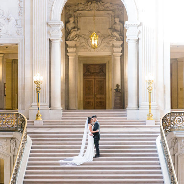 Maya and Kevin on the grand staircase of San Francisco City Hall