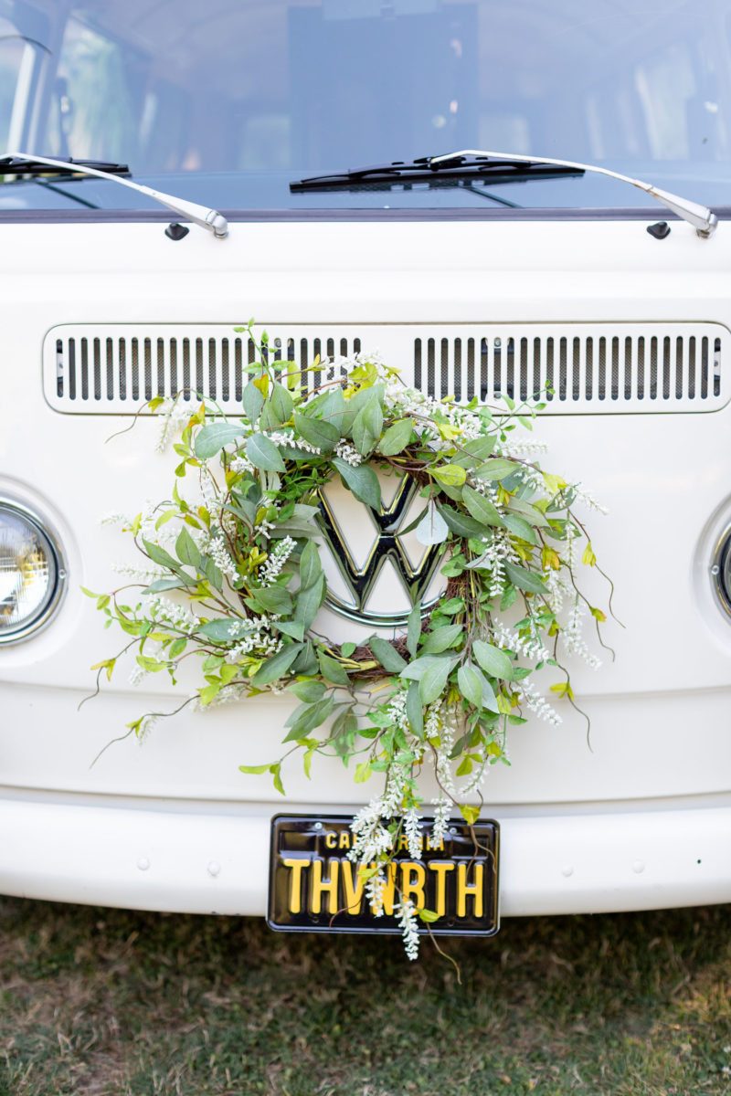 greenery wreath around VW logo at front of bus