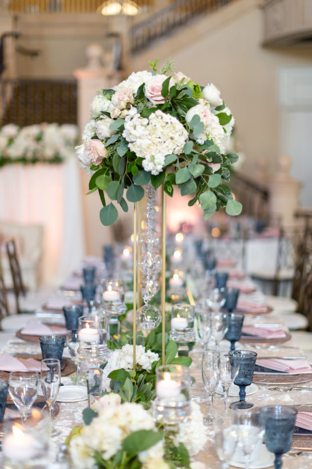 elegant table decor with flowers high above table