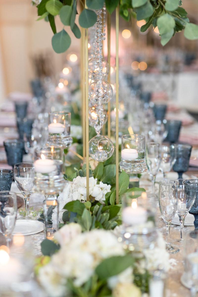 long table decor with pink, blue, and greenery