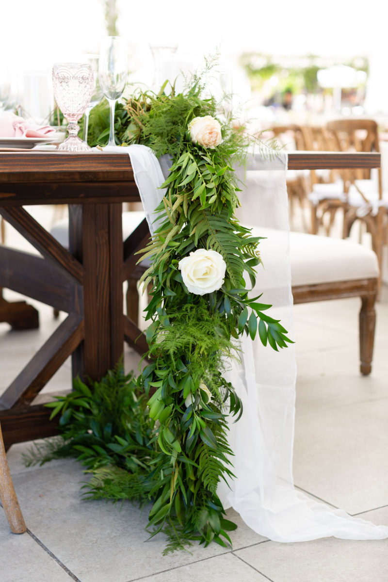 greenery cascading off long table