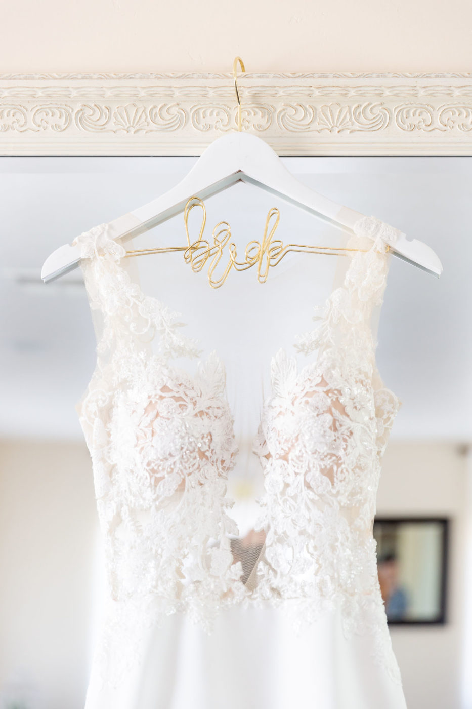 wedding dress in front of mirror with