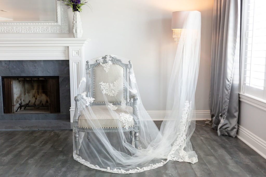 bridal veil draped over lamp and chair