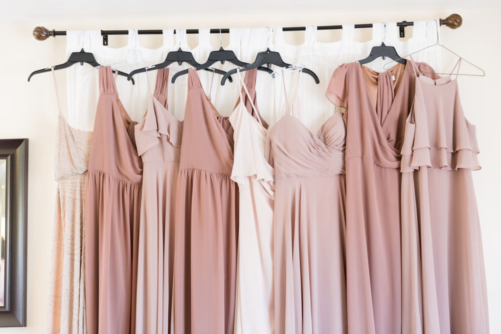 bridesmaid dresses - rose tones - handing on curtain rod