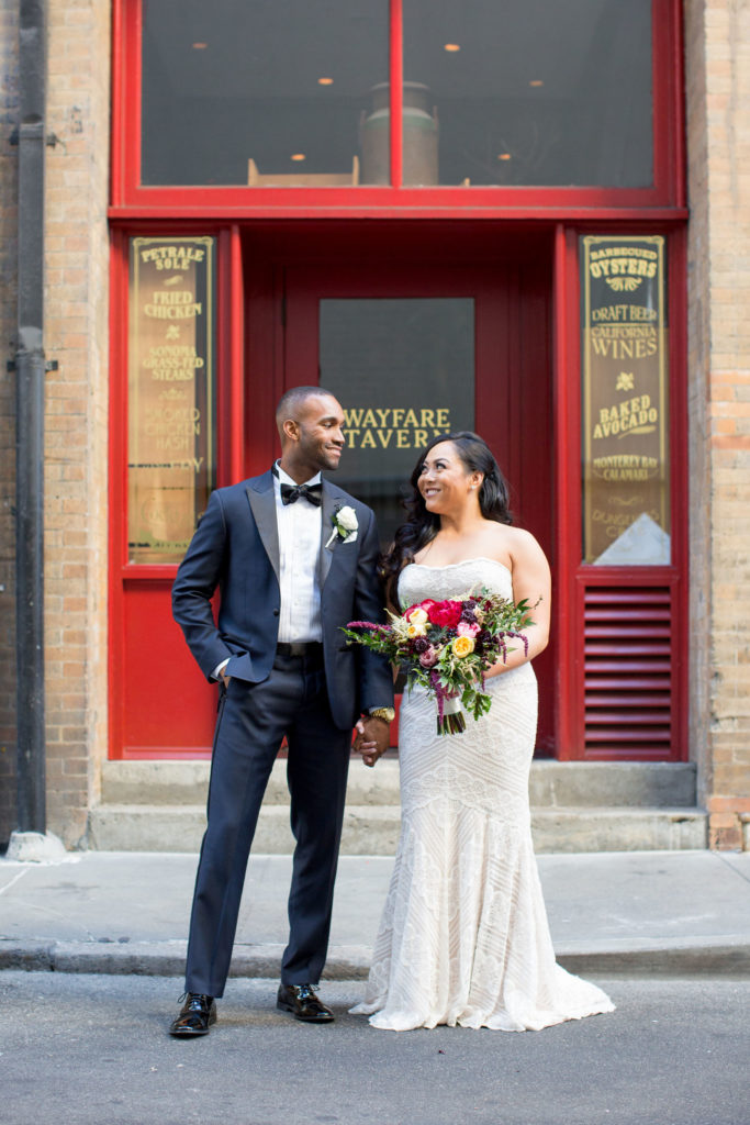 bride and groom in front of Wayfare Tavern